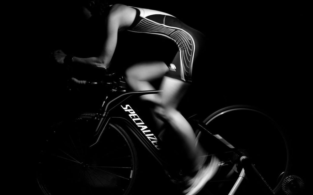 Cyclist on turbo trainer working their glute muscles