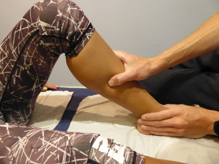 Body assessment routine with patient getting lower leg treated