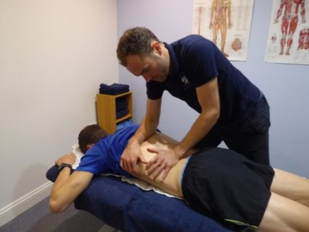 Shrewsbury sports massage therapy sports massage therapist performing a sports massage