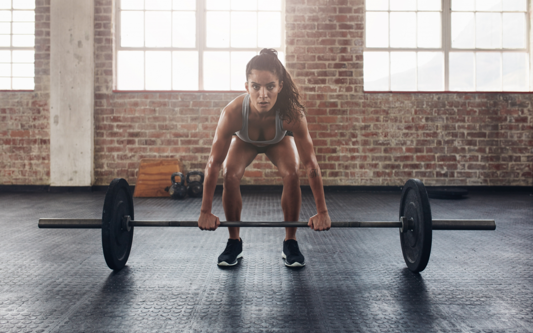 Female Endurance athlete lifting barbell
