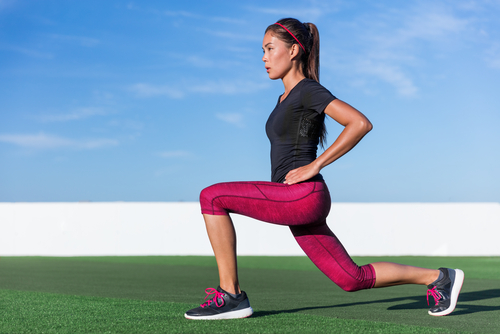 Lunging woman with hip flexed