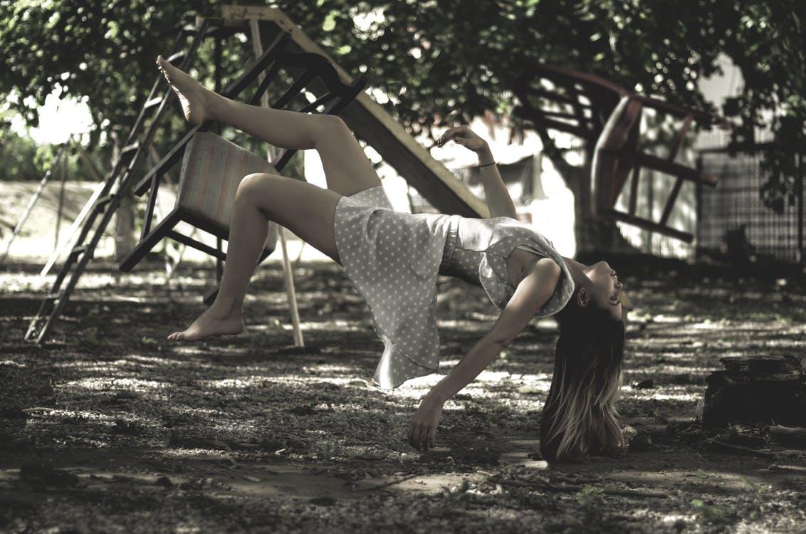 Woman falling off a swing