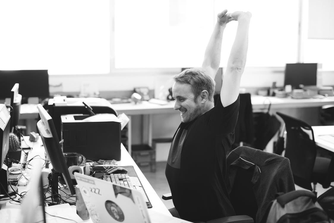 Man stretching after spending a long period at desk