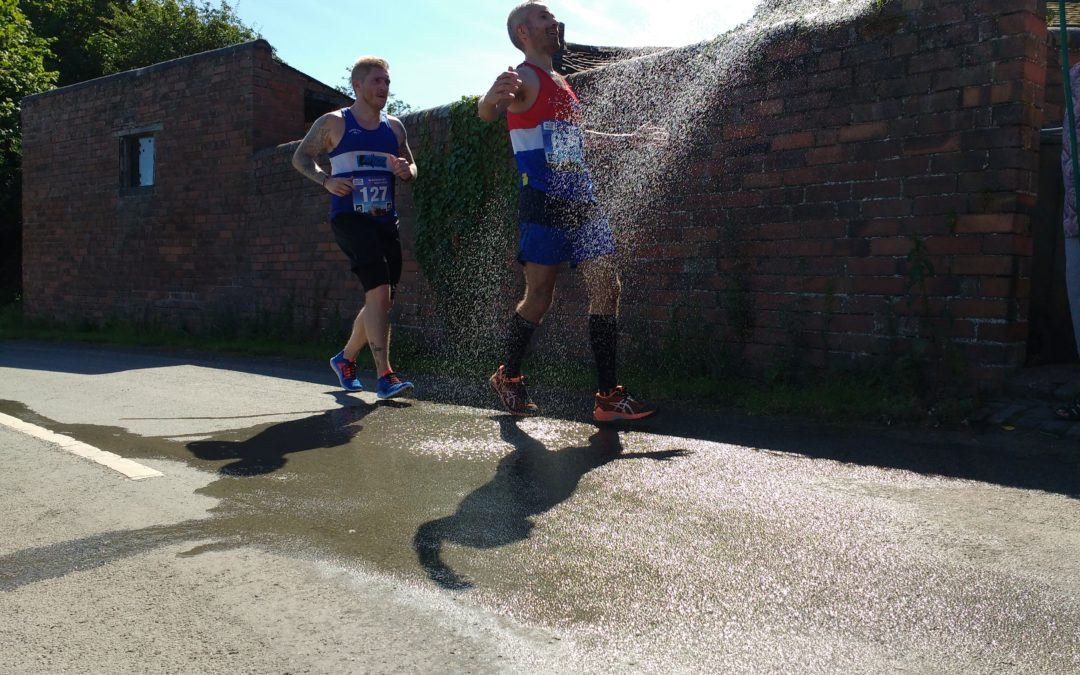 Runner getting cooled during half marathon