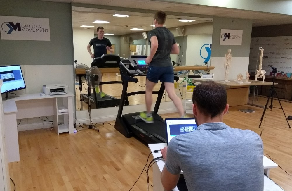 Runner on treadmill having gait analysed