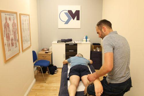 Shrewsbury sports massage therapy sports massage therapist performing a sports massage