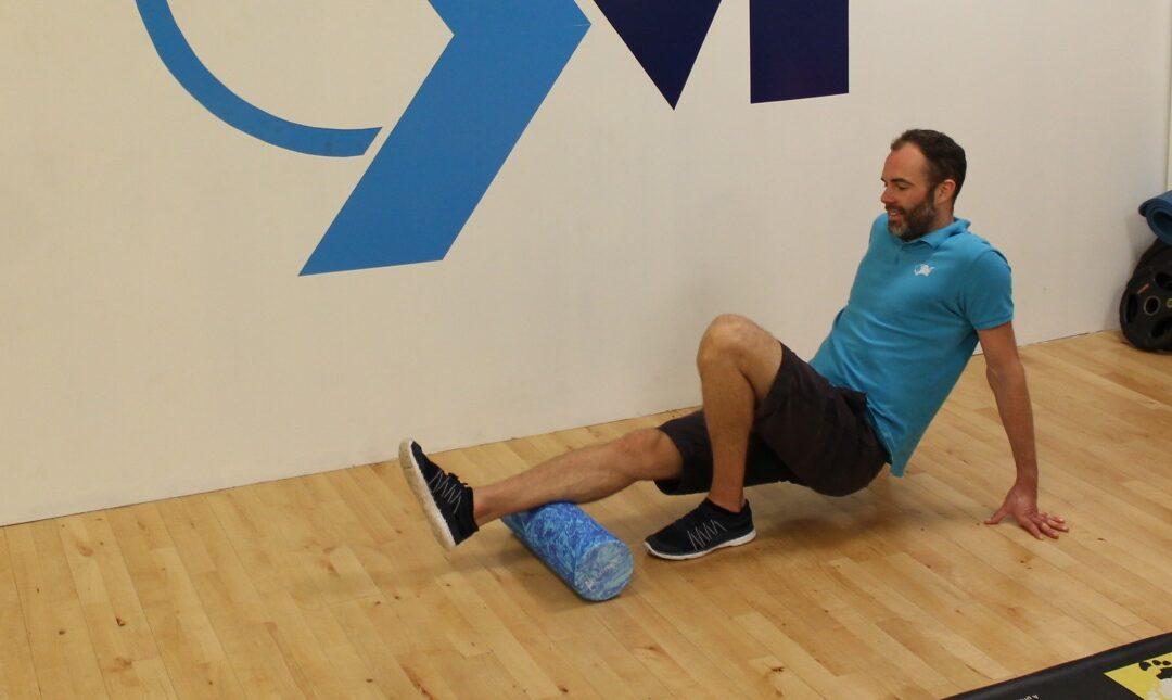 Foam rolling the legs in clinic