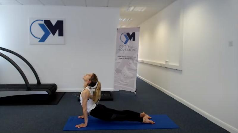 Yoga instructor doing a sun salutation pose